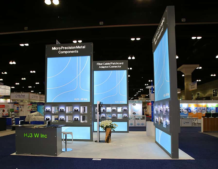 20x20 rental booth designed by exponents for Hj3w @ OFC , Los Angeles